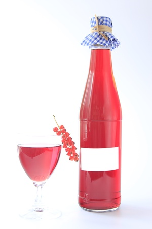 Fruit wine made from red currants with bottle and glass and one fruit against a white background Stock Photo - 15056345