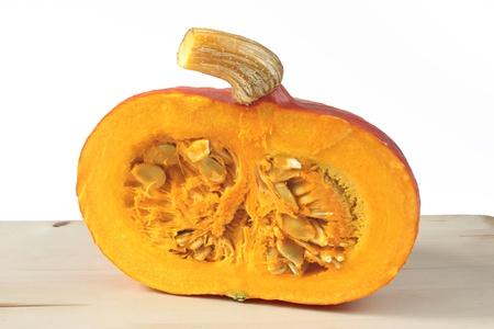 cucurbita: Cut hokkaido pumpkin on a cutting board  Cucurbita maxima  Stock Photo