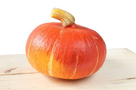 strikingly: Hokkaido pumpkin on a cutting board  Cucurbita maxima  Stock Photo
