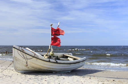 ウーゼドム島、ドイツのバルト海のビーチで釣りボート 写真素材