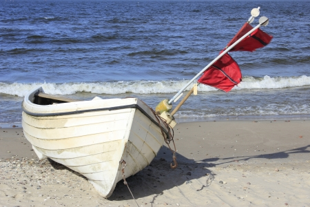 Fishing boat on the beach of the island of Usedom, Baltic Sea, Germany Stock Photo