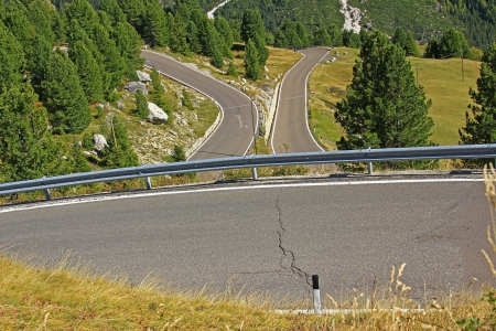 guard rail: Road with many hairpin bends in the Italian Alps at Passo Sella Stock Photo