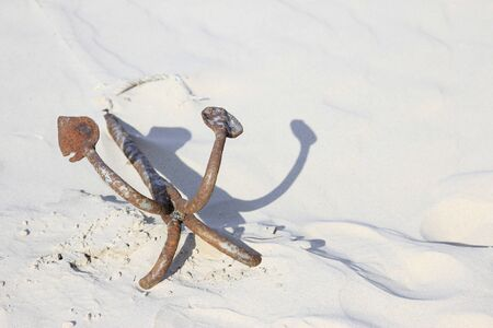 Anchor in the sand Stock Photo - 15585315