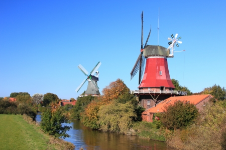 Windmills in Greetsiel, East Frisia, Lower Saxony, Germany