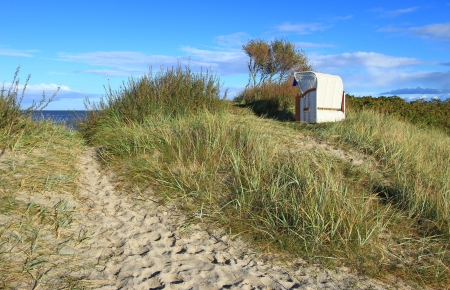 Beach chair in the sand dunes on the North Sea, Germany photo