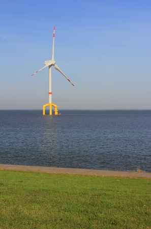 Offshore wind power plant in the North Sea near the shore, Germany photo