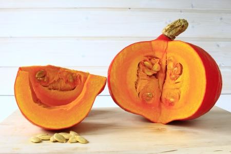 Hokkaido pumpkin, cut  Cucurbita maxima  Stock Photo