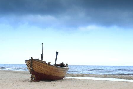 ashore: Fishing boat on the beach on the island of Usedom, Baltic Sea, Germany  Stock Photo