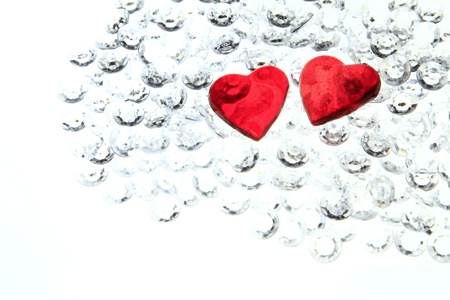 Two red hearts on glitter stones - symbol for Valentines Day Stock Photo - 17521441