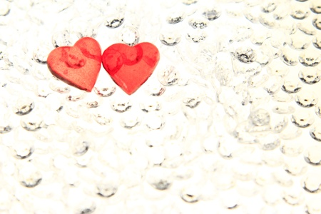 Two red hearts on glitter stones - symbol for Valentines Day Stock Photo - 17521675