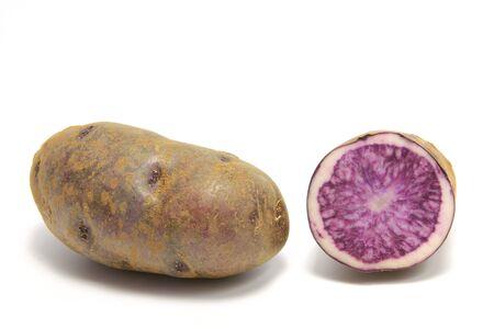 tuberosum: Blue Potatoes  Solanum tuberosum  isolated in front of white background