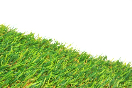 Synthetic grass in front of white background photo