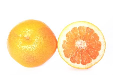 Halved Grapefruit isolated on white background  Citrus x aurantium  Citrus paradisi Stock Photo - 18850593