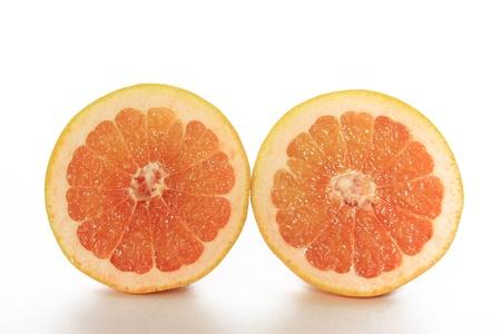 citrus family: Halved Grapefruit isolated on white background  Citrus x aurantium  Citrus paradisi