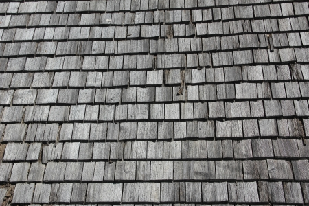 graying: Roof with old and weathered wooden shingles
