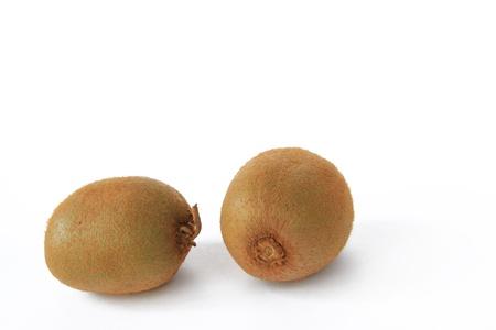 actinidia deliciosa: Two Kiwifruits  Actinidia deliciosa  isolated in front of white background Stock Photo