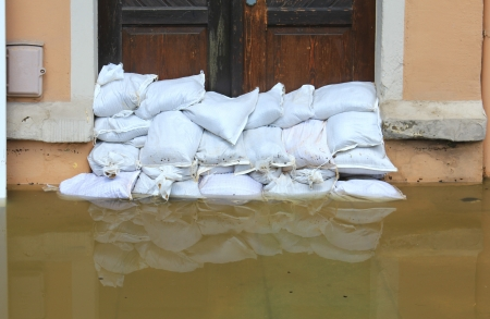 Sandbags stacked in front of a doorway in the old town of Meissen, Saxony, Germany - Flood in June 2013