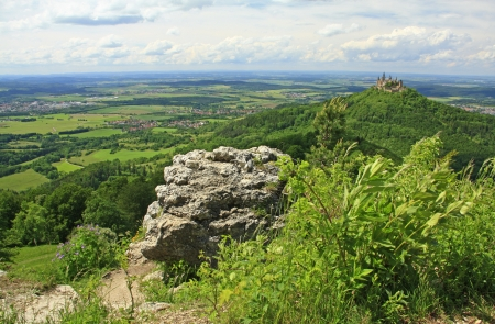 View from the peak of Zeller Horn to Hohenzollern Castle in the Swabian Alb, Baden-Wuerttemberg, Germany