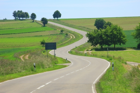 Curvaceous country road on the Swabian Alb, Baden-Wuerttemberg, Germany