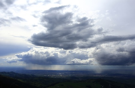 Rain cloud over the Rhine valley, view from the observation\ tower at the Schauinsland mountain, Black Forest,\ Baden-Wuerttemberg, Germany