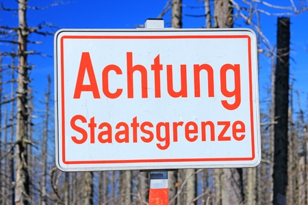 Sign Attention state border on the border of Germany, Austria, Czech Republic, Bavarian Forest, Sumava National Park photo