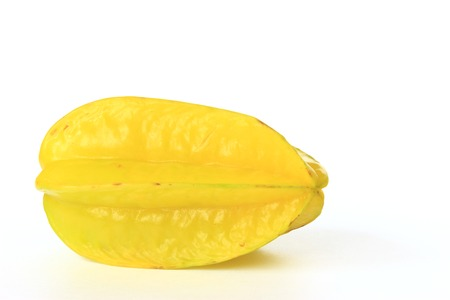 Carambola or star fruit  Averrhoa carambola  isolated in front of a white background photo
