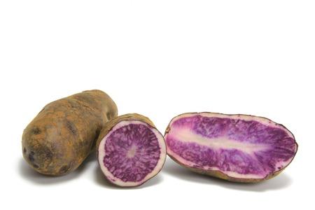 tuberosum: Blue Potatoes, Solanum tuberosum isolated in front of white background