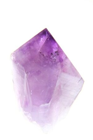 Amethyst crystal isolated against a white background