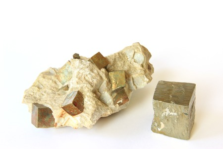 Pyrite crystals in the source rock and single cubic crystal