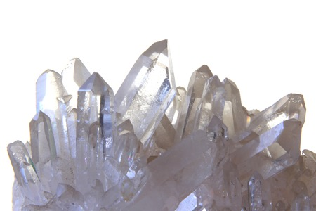 crystal background: Rock crystal with many single crystals in front of white background