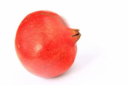 punica granatum: Ripe pomegranate  Punica granatum  in front of white background