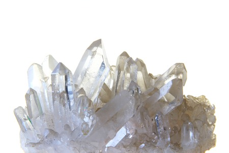 Rock crystal with many single crystals in front of white background