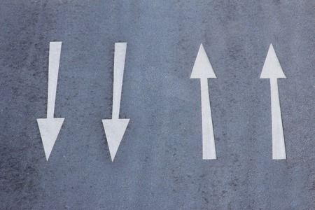 back and forth: Direction arrows on a road Stock Photo