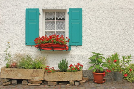 Decorative wooden window with floral decorations in Monreal, Eifel, Rhineland-Palatinate, Germany photo