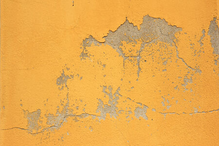 flaking: Peeling paint and cracks in a wall