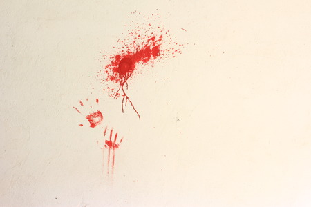 smudge: Smudge of color and prints of hands with red paint on a bright wall Stock Photo