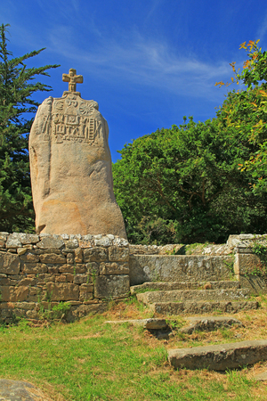 pagan cross: The christianized menhir of Saint Uzec, Tr?beurden, France Stock Photo