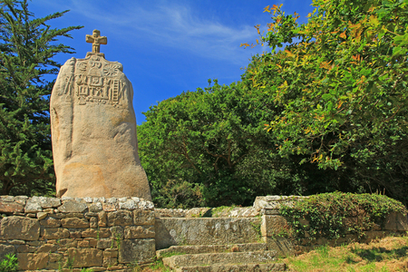 gentile: The christianized menhir of Saint Uzec, Tr?beurden, France Stock Photo