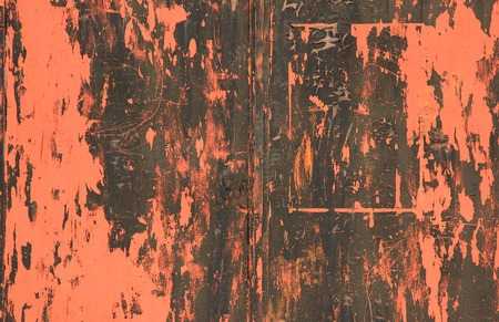 Red painted metal sheet, flaking, weathered photo