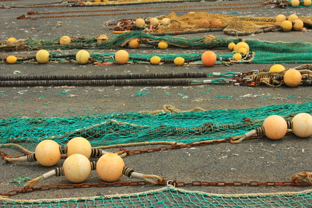 fishing nets: Fishing nets spread on the ground to dry in a fishing port in Brittany, France