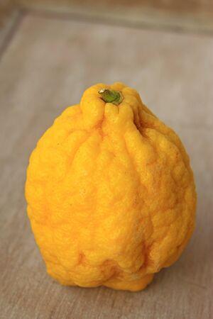 citron: Citron (Citrus medica) on an old board Stock Photo