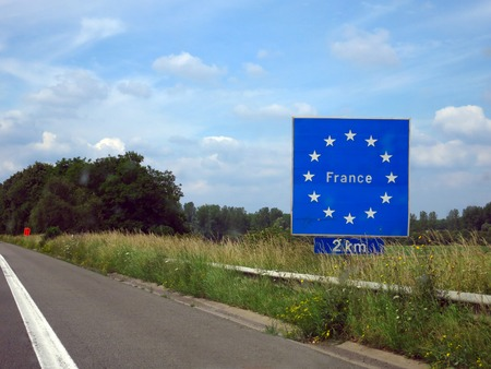guard rail: Sign on the highway from Belgium to France \France 2 km Stock Photo