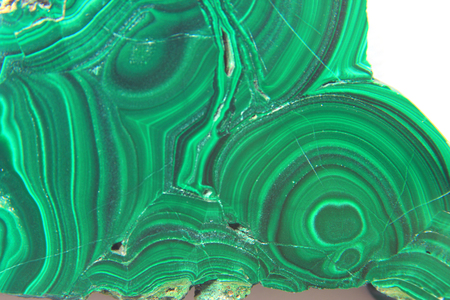 malachite: Malachite in front of white background, carbonate with the chemical formula Cu2 [(OH) 2 | CO3] Stock Photo