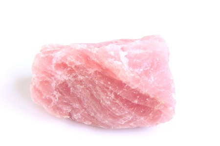 Rose quartz, rough stone in front of white background - silicate mineral with the chemical formula SiO2