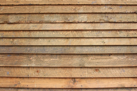 laths: Background of brown, unpainted wooden boards Stock Photo