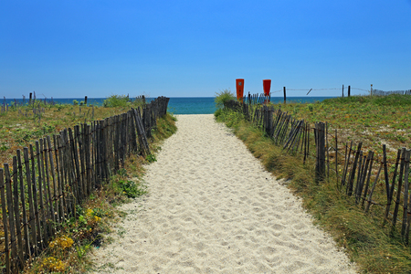 path to romance: Beach access on the Atlantic coast in Brittany, France Stock Photo
