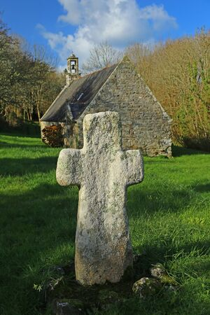 green cross: Stone Cross at the Chapel of St. Julien near Camaret-sur-Mer, Finistre region, Brittany, France