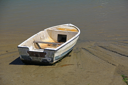 old rowing boat on the beach at low tide