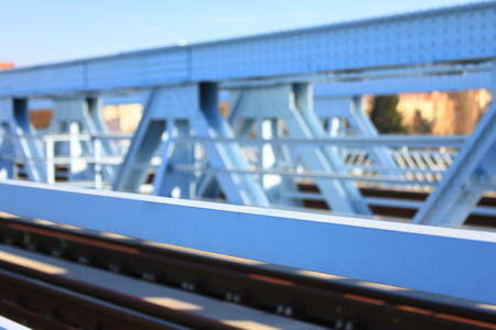 riveted: Riveted steel construction of a bridge as blurred background