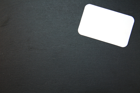 writable: Blackboard (slate) with blank, writable notepad Stock Photo